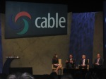 Erin Burnett, Sanjay Jha, Thomas Rutledge or Cablevision Systems and Brian Roberts of Comcast,